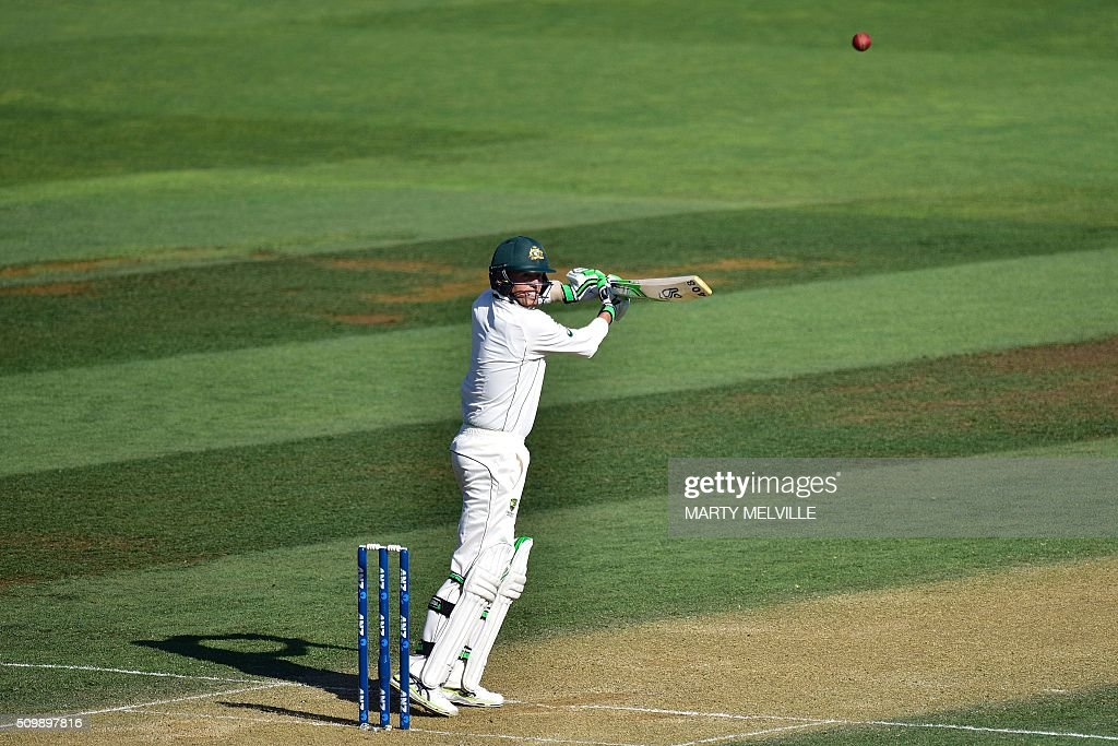 Peter Siddle of Australia plays a shot during day two of the first cricket Test match between New Zealand and Australia at the Basin Reserve in Wellington on February 13, 2016. AFP PHOTO / MARTY MELVILLE / AFP / Marty Melville