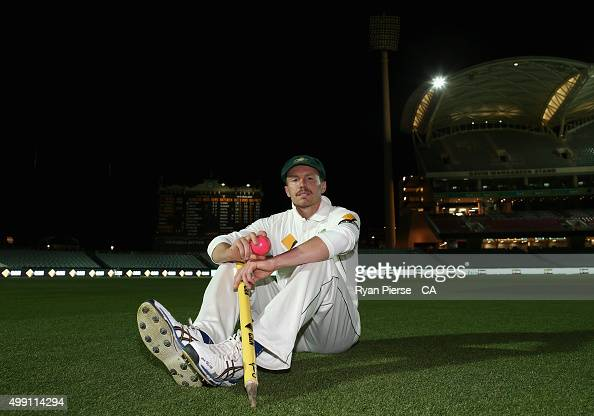 Peter Siddle of Australia poses on the ground after claiming his 200th Test wicket during day three of the Third Test match between Australia and New...