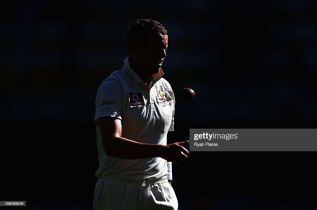 <a gi-track='captionPersonalityLinkClicked' href=/galleries/search?phrase=Peter+Siddle&family=editorial&specificpeople=2104718 ng-click='$event.stopPropagation()'>Peter Siddle</a> of Australia prepares to bowl during day five of the First Test match between Australia and South Africa at The Gabba on November 13, 2012 in Brisbane, Australia.