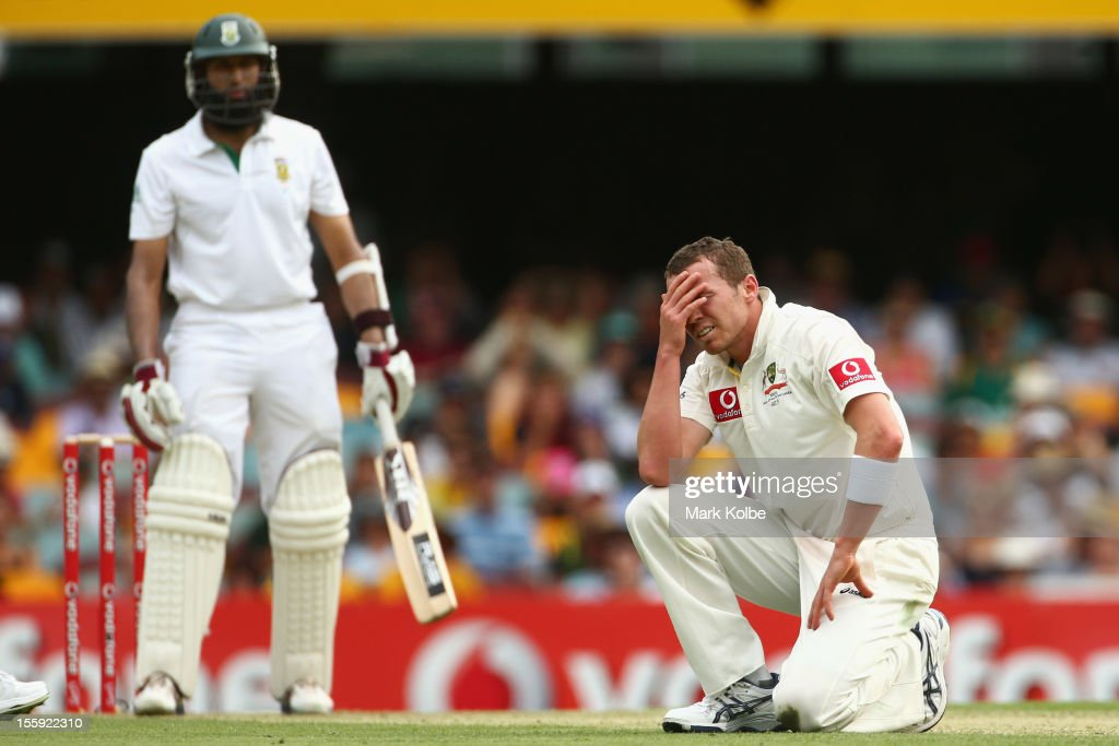 <a gi-track='captionPersonalityLinkClicked' href=/galleries/search?phrase=Peter+Siddle&family=editorial&specificpeople=2104718 ng-click='$event.stopPropagation()'>Peter Siddle</a> of Australia reacts after he dropped a caught and bowled chance from Hashim Amla of South Africa only to have it over rules due to a no-ball during day one of the First Test match between Australia and South Africa at The Gabba on November 9, 2012 in Brisbane, Australia.