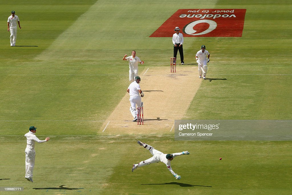 Peter Siddle of Australia watches wicket keeper Matthew Wade attempt to stop the ball during day three of the Second Test Match between Australia and South Africa at Adelaide Oval on November 24, 2012 in Adelaide, Australia.
