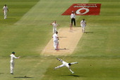Peter Siddle of Australia watches wicket keeper Matthew Wade attempt to stop the ball during day three of the Second Test Match between Australia and...