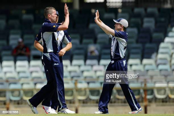 Peter Siddle of the Bushrangers celebrates after taking the wicket of Cameron Bancroft of the Warriors during the JLT One Day Cup match between...