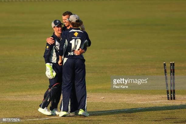 Peter Siddle of the Bushrangers celebrates the wicket of Simon Milenko of the Tigers with Sam Harper and Will Pucovski during the JLT One Day Cup...