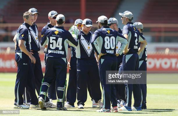Peter Siddle of the Bushrangers celebrates with team mates after taking the wicket of Tom Cooper of the Redbacks during the JLT One Day Cup match...