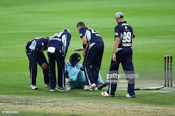 Peter Siddle of the Bushrangers checks Daniel Hughes of the Blues after being struck on the helmet by a short delivery during the Matador BBQs One...