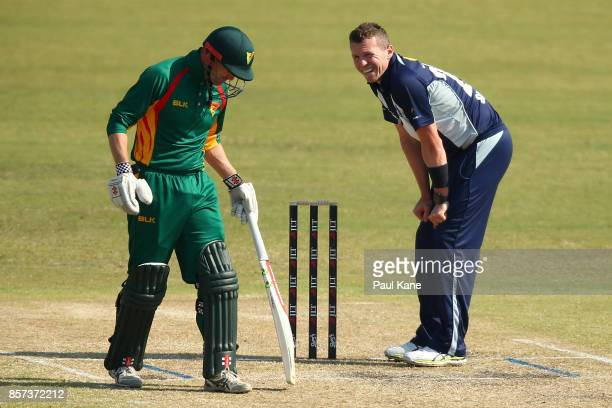 Peter Siddle of the Bushrangers looks back to George Bailey of the Tigers during the JLT One Day Cup match between Victoria and Tasmania at WACA on...