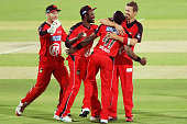 Peter Siddle of the Renegades celebrates with teammates after getting the wicket of Michael Klinger of the Strikers during the Big Bash League match...