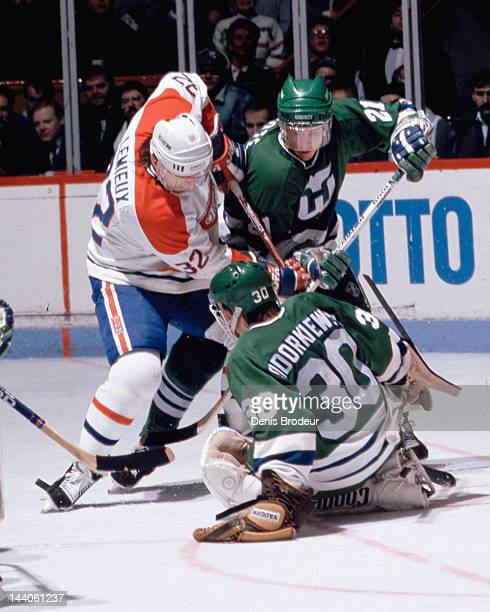 Peter Sidorkiewicz of the Hartford Whalers makes a save on a shot by Claude Lemieux of the Montreal Canadiens Circa 1990 at the Montreal Forum in...