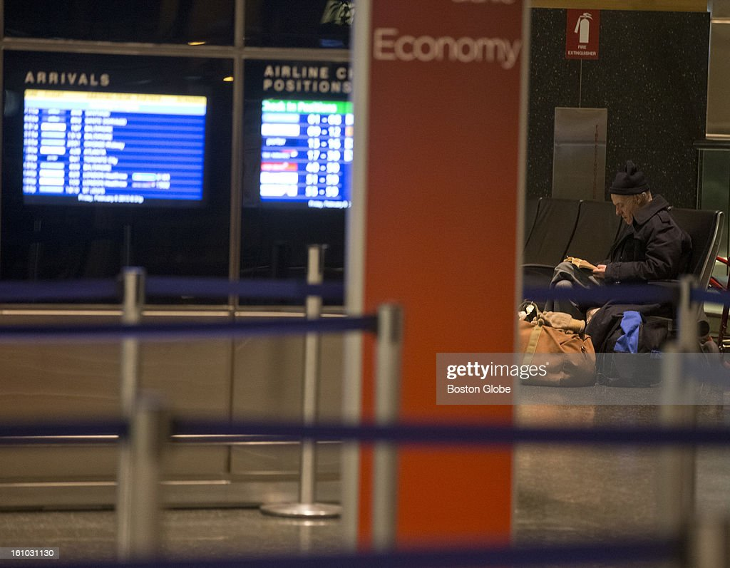 Peter Simons, 65, waits for his flight to Paris, France. He is stranded at Terminal E at Logan Airport on Friday, Feb. 8, 2013. Simons is homeless and looking to get out of Boston after getting robbed three times since his arrival in October.