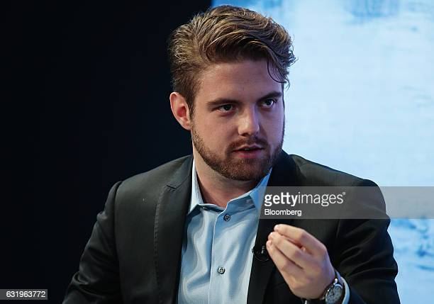 Peter Smith chief executive officer of Blockchain Ltd gestures as he speaks during a panel session at the World Economic Forum in Davos Switzerland...