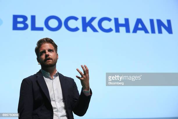 Peter Smith chief executive officer of Blockchain Ltd gestures as he speaks during the Noah technology conference in Berlin Germany on Thursday June...