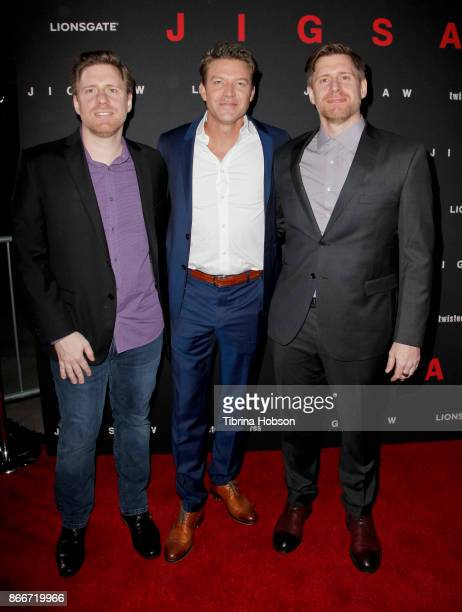 Peter Spierig Matt Passmore and Michael Spierig attend the premiere of Lionsgate's 'Jigsaw' at ArcLight Hollywood on October 25 2017 in Hollywood...