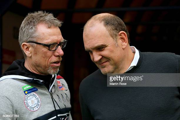 Peter Stoeger head caoch Koeln tlks to sport director Joerg Schmadtke before the Bundesliga match between Hamburger SV and 1 FC Koeln at...