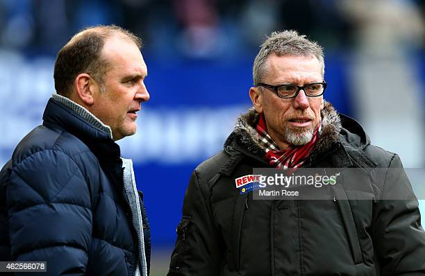 Peter Stoeger head caoch of Koeln talks to sport director Joerg Schmadtke before the Bundesliga match between Hamburger SV and 1 FC Koeln at Imtech...