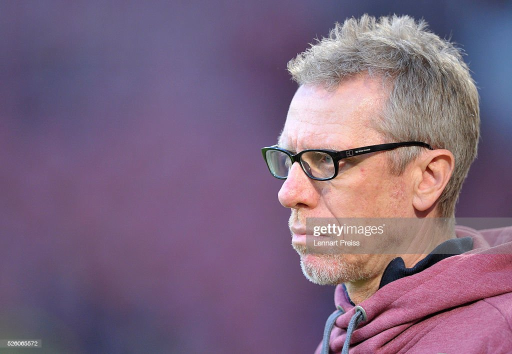 Peter Stoeger, head coach of 1. FC Koeln looks on before the Bundesliga match between FC Augsburg and 1. FC Koeln at WWK Arena on April 29, 2016 in Augsburg, Germany.