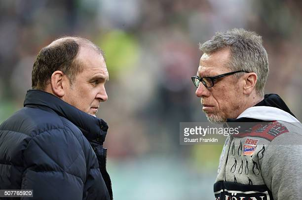 Peter Stoeger head coach of Cologne in discussion with Joerg Schmadtke athletic director of Colonge prior to the Bundesliga match between VfL...