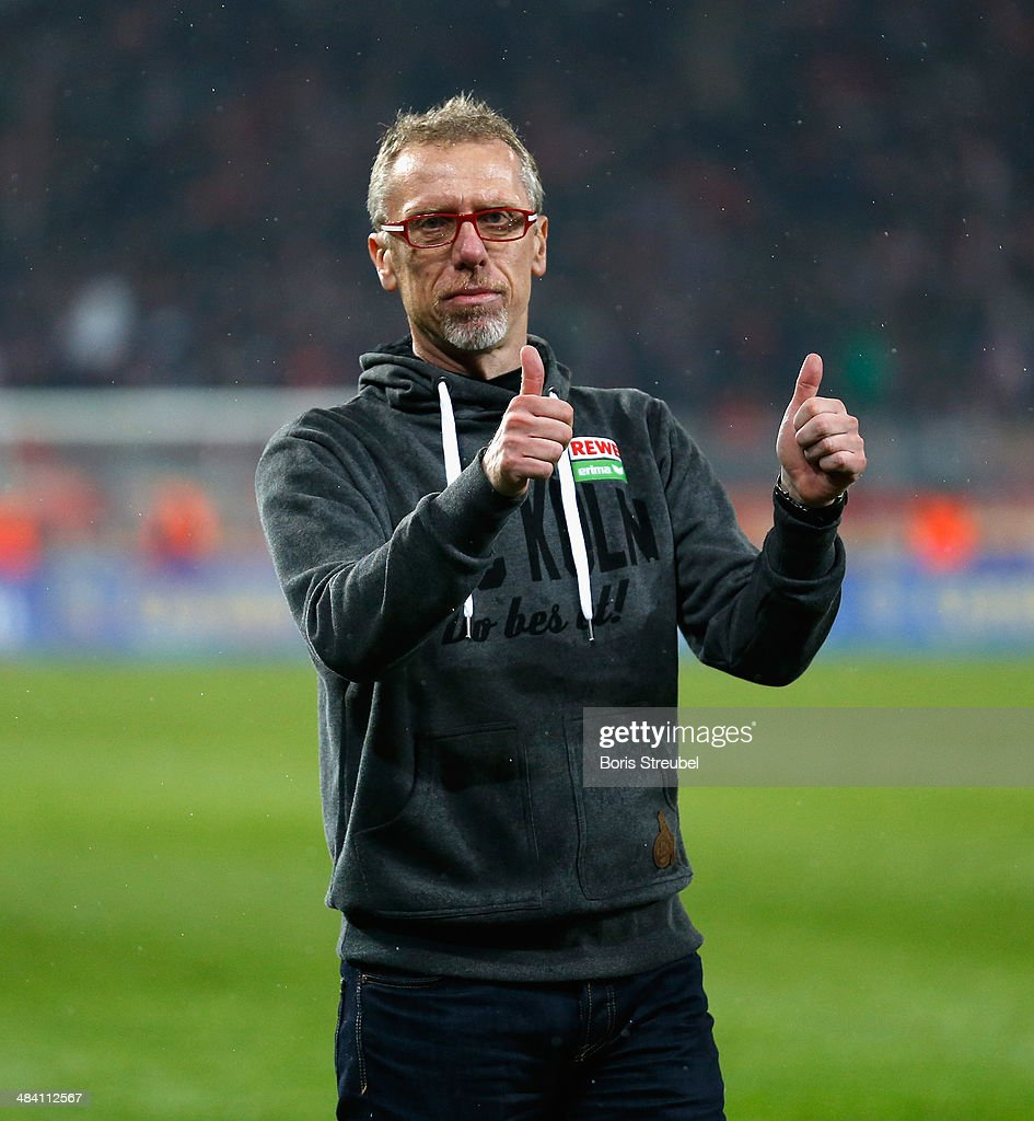Peter Stoeger head coach of Koeln celebrates with his fans after winning the Second Bundesliga match between 1FC Union Berlin and 1 FC Koeln at...