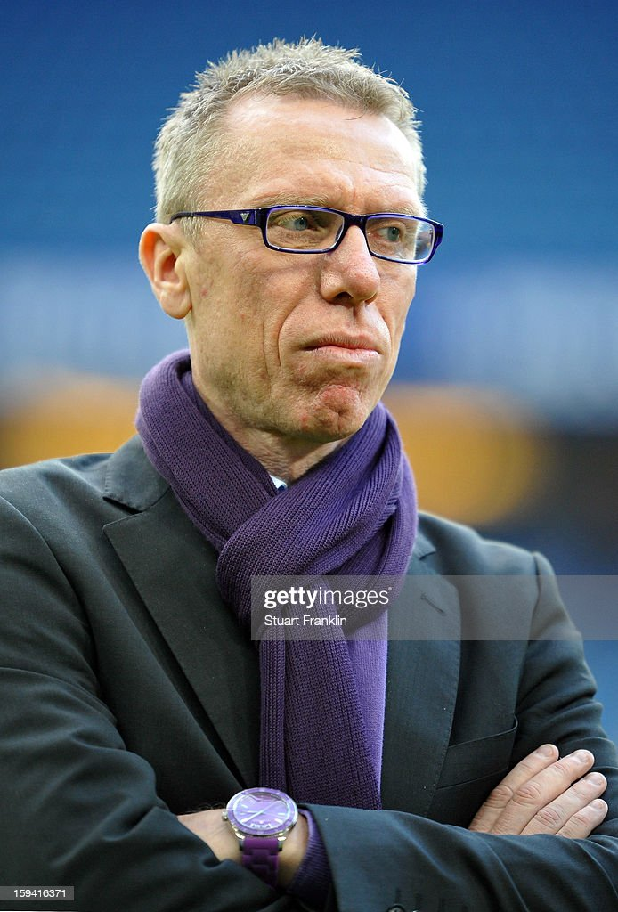 Peter Stoeger, head coach of Vienna ponders during the international friendly match between Hamburger SV and Austria Wien at Imtech Arena on January 12, 2013 in Hamburg, Germany.