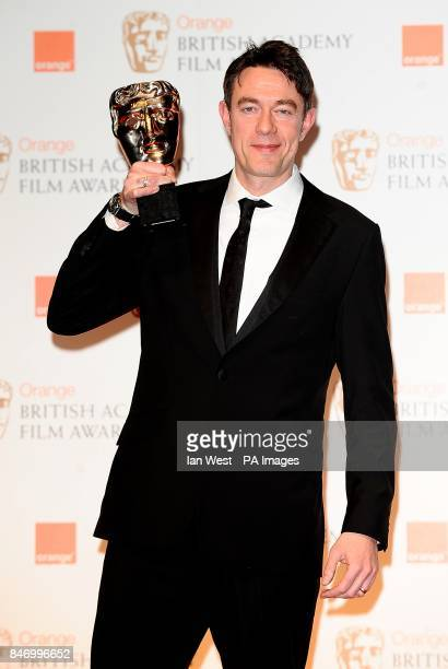 Peter Straughan with the Adapted Screenplay award for 'Tinker Tailor Soldier Spy' in the press room at the 2012 Orange British Academy Film Awards at...