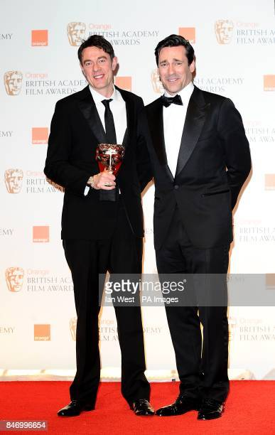 Peter Straughan with the Adapted Screenplay award for 'Tinker Tailor Soldier Spy' and presenter Jon Hamm in the press room at the 2012 Orange British...