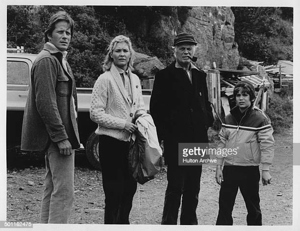 Peter Strauss Dee Wallace Richard Widmark and David Hollander look on the beach in the Television movie 'A Whale for the Killing' circa 1981