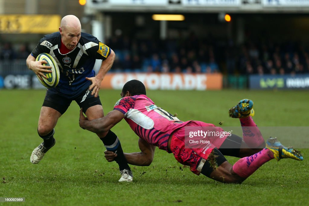 <a gi-track='captionPersonalityLinkClicked' href=/galleries/search?phrase=Peter+Stringer&family=editorial&specificpeople=217507 ng-click='$event.stopPropagation()'>Peter Stringer</a> of Bath is tackled by Watisoni Votu of Exeter Chiefs during the LV= Cup match between Bath and Exeter Chiefs at the Recreation Ground on January 26, 2013 in Bath, England.