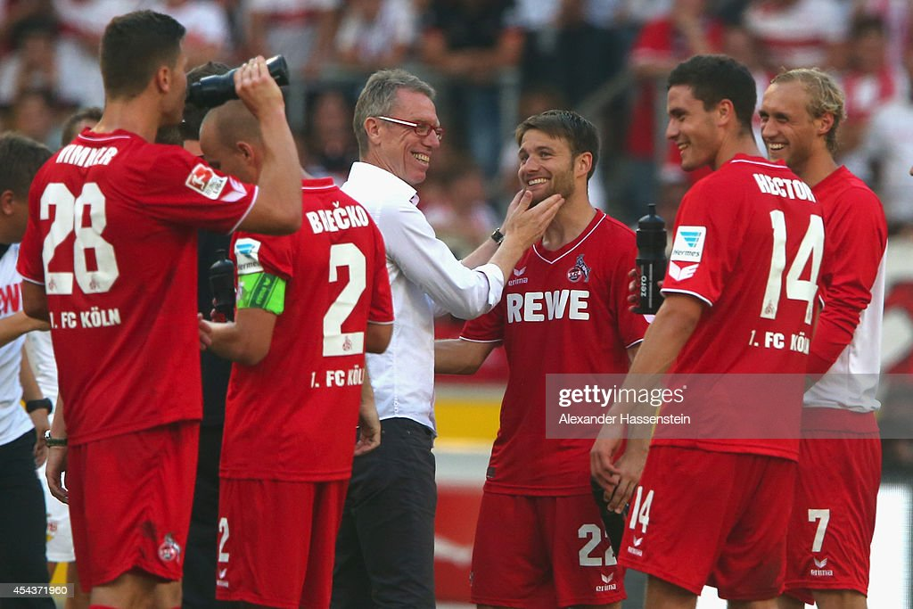 Peter Stroeger, head coach of Koeln celebrates with his player <a gi-track='captionPersonalityLinkClicked' href=/galleries/search?phrase=Daniel+Halfar&family=editorial&specificpeople=649082 ng-click='$event.stopPropagation()'>Daniel Halfar</a> and other after winning the Bundesliga match between VfB Stuttgart and 1. FC Koeln at Mercedes-Benz Arena on August 30, 2014 in Stuttgart, Germany.