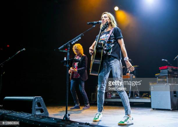 Peter Stroud and Sheryl Crow perform during The 2017 Outlaw Festival at Joe Louis Arena on July 8 2017 in Detroit Michigan