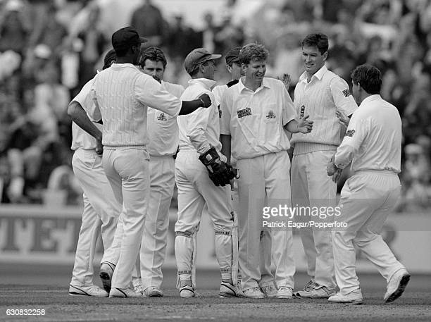 Peter Such of England is congratulated after taking his first Test wicket on debut during the 1st Test match between England and Australia at Old...