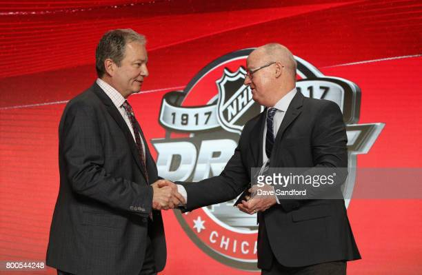 Peter Sullivan a senior scout with NHL Central Scouting presents general manager Ray Shero of the New Jersey Devils on behalf of first draft pick...