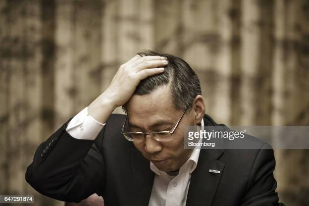 Peter Sun chairman and chief executive officer of Inspur Group Co reacts during an interview in Beijing China on Thursday March 2 2017 Inspur...
