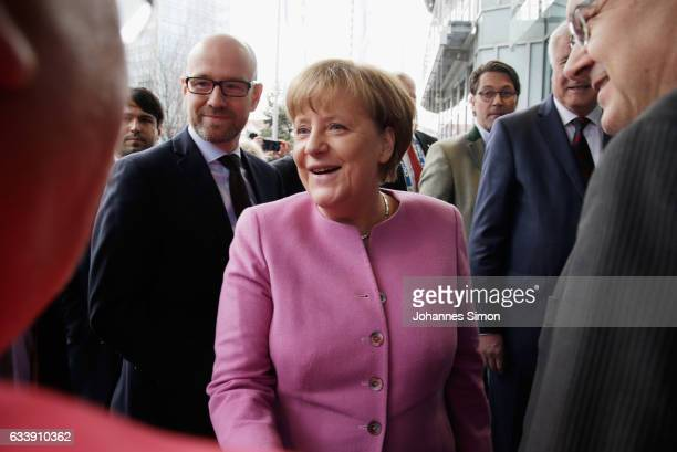 Peter Tauber general secretary of the German Christian Democrats and German Chancellor and Chairwoman of the German Christian Democrats Angela Merkel...