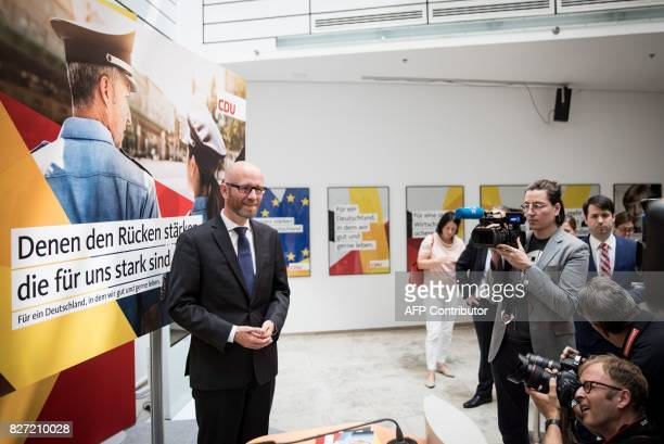 Peter Tauber secretary general of the conservative Christian Democratic Union party presents campaign posters for the upcoming general elections at...