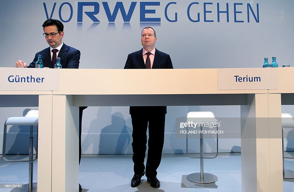 Peter Terium, chairman of Germany's second biggest-power supplier RWE (R) and RWE's CFO Bernhard Guenther attend the annual press conference on March 5, 2013 in Essen, western Germany. The energy giant RWE announced on March 5, 2013 that they have seen a massive drop in profits for 2012.