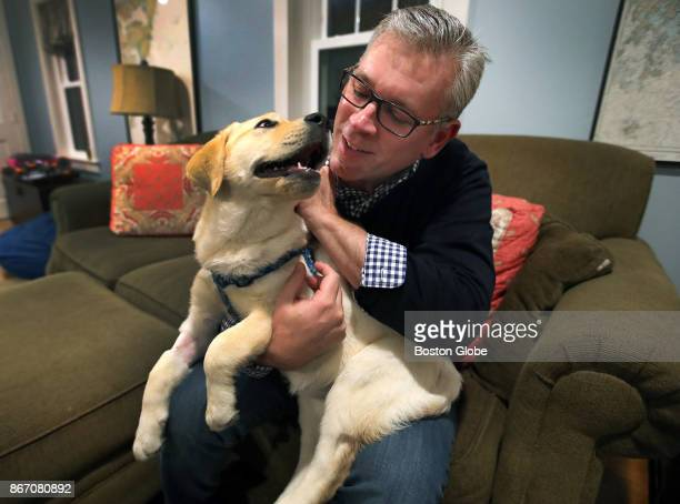 Peter Thibault holds his his 3monthold yellow labrador puppy named Zoey at his home in Andover MA on Oct 26 2017 Zoey had to be injected with...