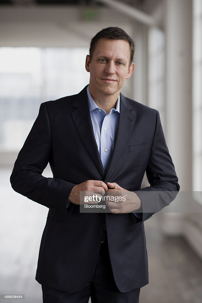 Peter Thiel cofounder of PayPal Inc buttons his jacket as he stands for a photograph before a Bloomberg Studio 10 Interview in San Francisco...