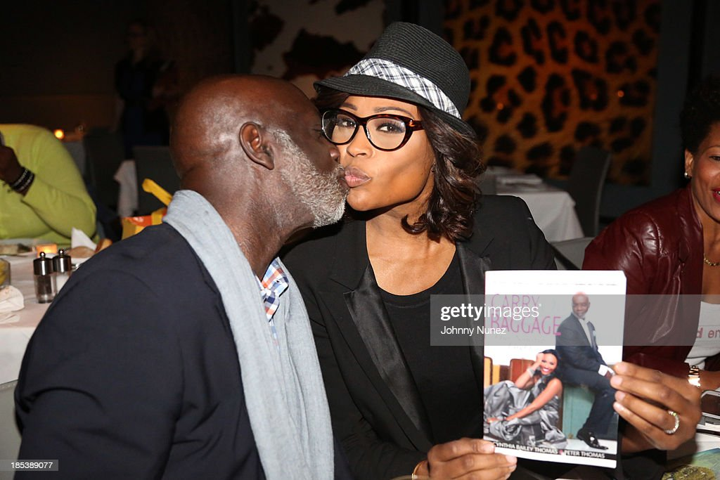 Peter Thomas and <a gi-track='captionPersonalityLinkClicked' href=/galleries/search?phrase=Cynthia+Bailey&family=editorial&specificpeople=3055318 ng-click='$event.stopPropagation()'>Cynthia Bailey</a> attend the launch event for their book 'Carry-On Baggage: Our Non-stop Flight' at Clyde Frazier's Wine and Dine on October 19, 2013 in New York City.
