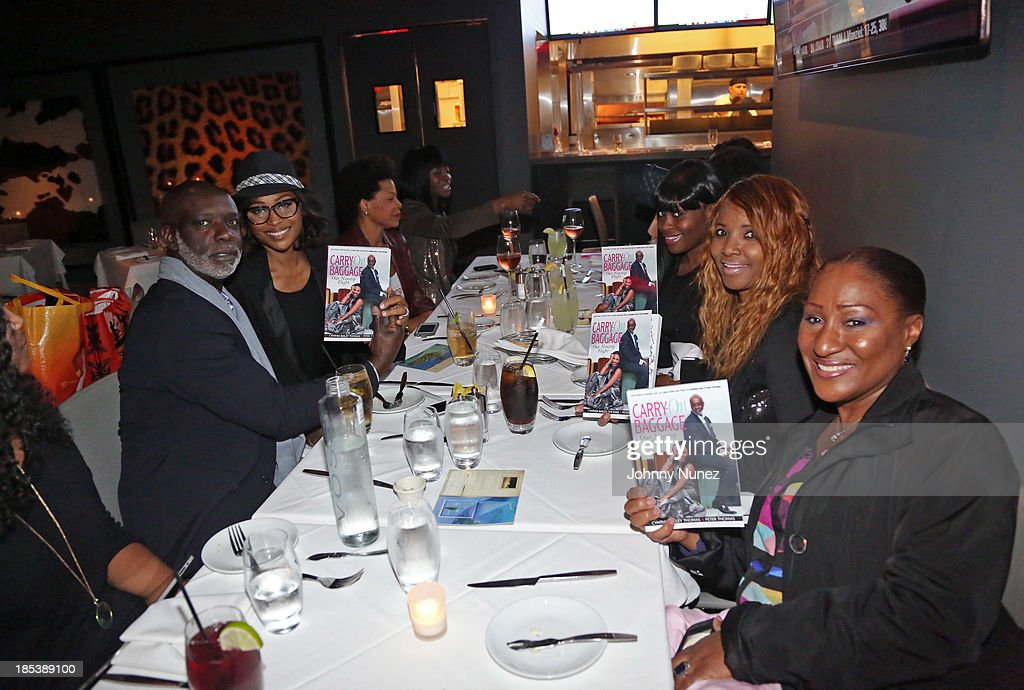 Peter Thomas, <a gi-track='captionPersonalityLinkClicked' href=/galleries/search?phrase=Cynthia+Bailey&family=editorial&specificpeople=3055318 ng-click='$event.stopPropagation()'>Cynthia Bailey</a>, and guests attend the book launch for 'Carry-On Baggage: Our Non-stop Flight,' by <a gi-track='captionPersonalityLinkClicked' href=/galleries/search?phrase=Cynthia+Bailey&family=editorial&specificpeople=3055318 ng-click='$event.stopPropagation()'>Cynthia Bailey</a> and Peter Thomas at Clyde Frazier's Wine and Dine on October 19, 2013 in New York City.