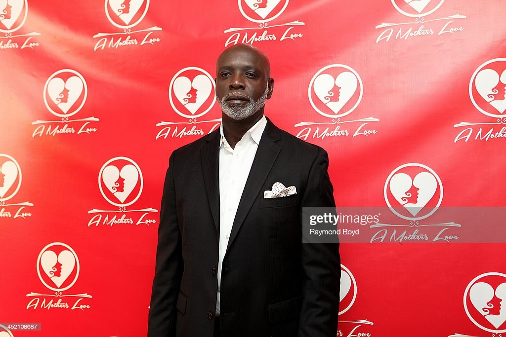 Peter Thomas from Bravo's 'Real Housewives Of Atlanta' poses for red carpet photos for 'A Mother's Love' stage play at the Rialto Center For The Arts in Atlanta, Georgia on NOVEMBER