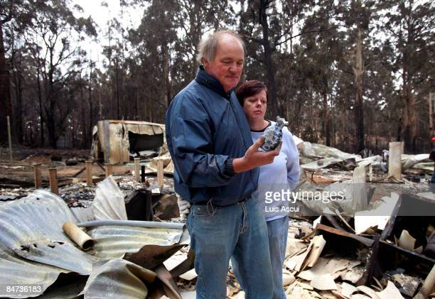 Peter Thorpe and Marylou Neal stand amid the ruins of their house on Glenburn Road Kinglake in the aftermath of the bushfires which continue to blaze...
