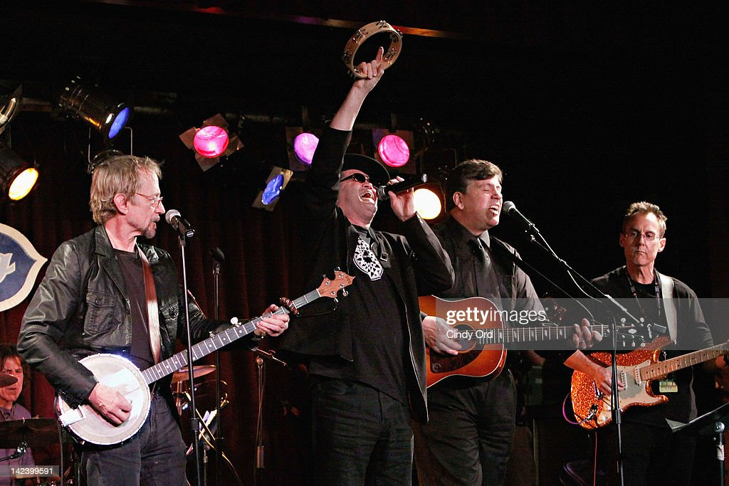 Peter Tork and Micky Dolenz of The Monkees perform with Dave Alexander at The Davy Jones Memorial 'An Evening of Music Memories' at BB King Blues...