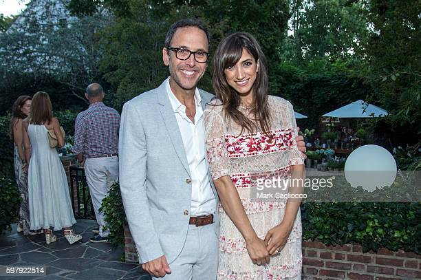 Peter Traugott and EBTH Chief Brand Officer Mandana Dayani attend the Ashley And Jeff McDermott host an intimate Hamptons party for EBTH on August 28...