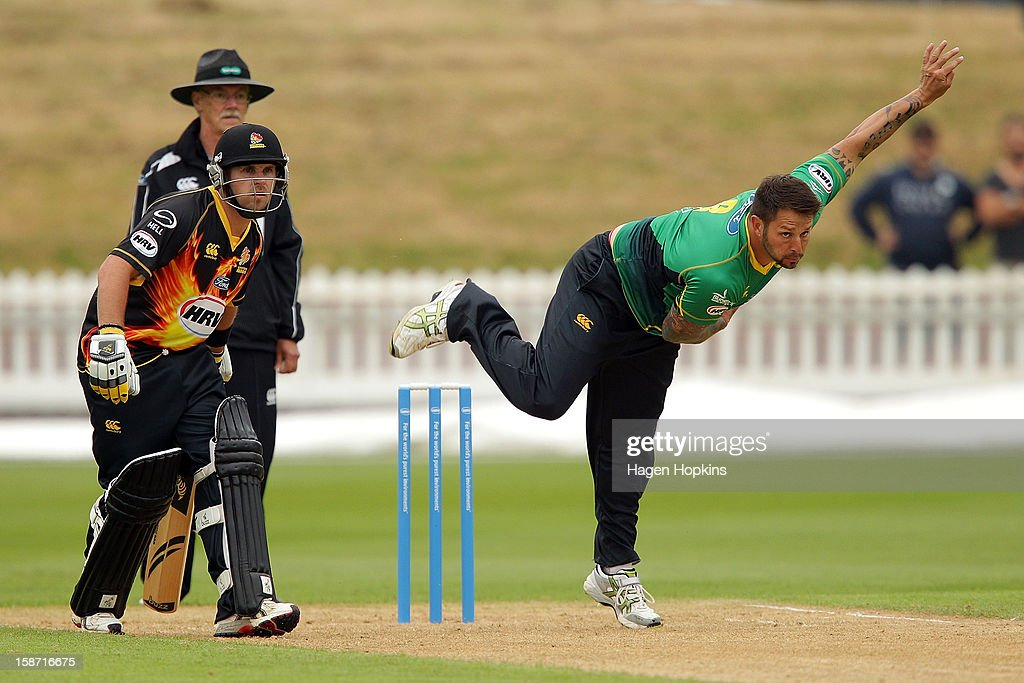 Peter Trego of Central Districts bowls while Michael Papps of Wellington looks on during the Twenty20 match between Wellington Firebirds and Central Stags at Hawkins Basin Reserve on December 26, 2012 in Wellington, New Zealand.