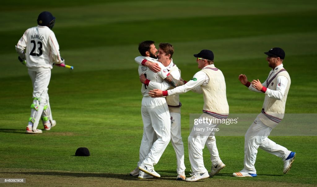Peter Trego of Somerset (2L) celebrates after dismissing Haseeb Hameed of Lancashire during Day Two of the Specsavers County Championship Division One match between Somerset and Lancashire at The Cooper Associates County Ground on September 13, 2017 in Taunton, England.