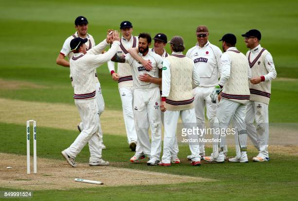 Peter Trego of Somerset celebrates with his teammates after dismissing Rory Burns of Surrey during day two of the Specsavers County Championship...