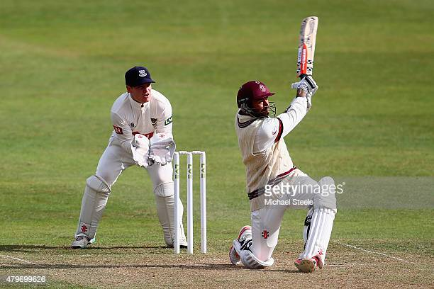 Peter Trego of Somerset hits a six off the bowling of Syed Zaidi of Sussex as wicketkeeper Ben Brown looks on during day two of the LV County...
