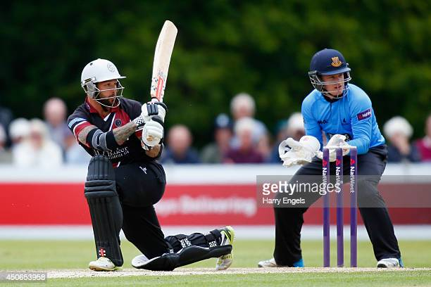 Peter Trego of Somerset hits out as Sussex wicketkeeper Ben Brown looks on during the Natwest T20 Blast match between Sussex Sharks and Somerset at...