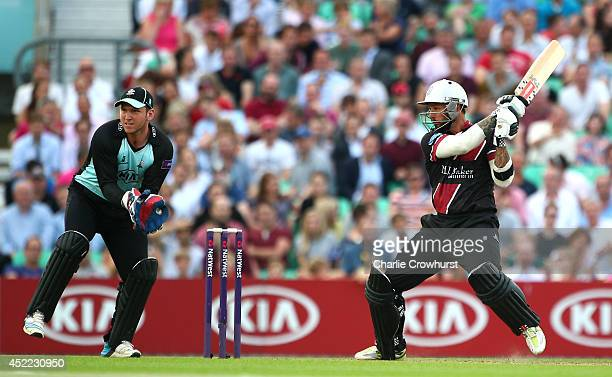Peter Trego of Somerset hits out while Surrey's Gary Wilson looks on during the Natwest T20 Blast match between Surrey and Somerset at The Kia Oval...