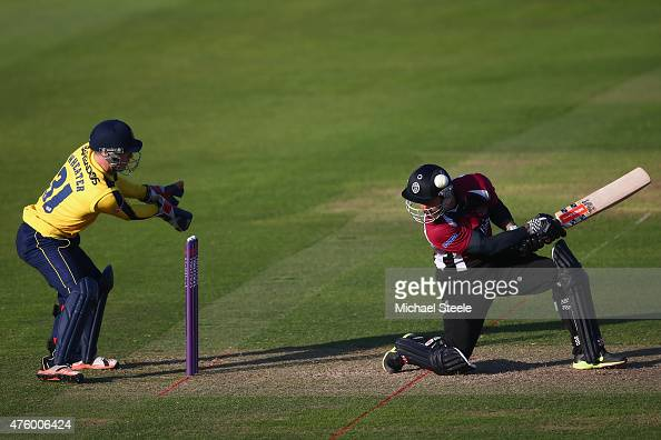 Peter Trego of Somerset is struck on the helmet as wicketkeeper Adam Wheater of Hampshire looks on during the NatWest T20 Blast match between...